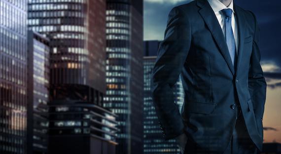 ビジネスマンと建物の背景